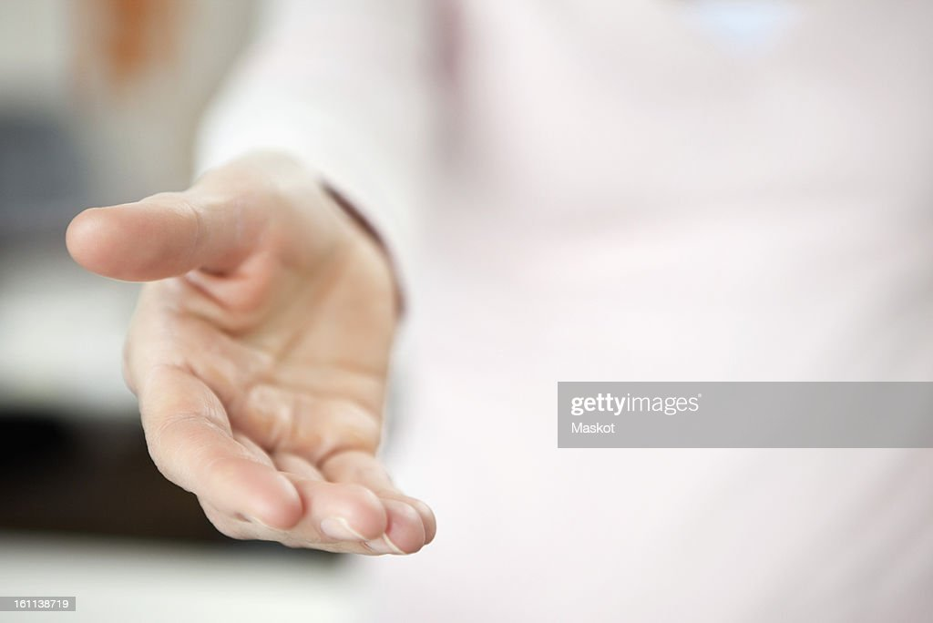 Close-up of a person holding out helping hand : Stock Photo