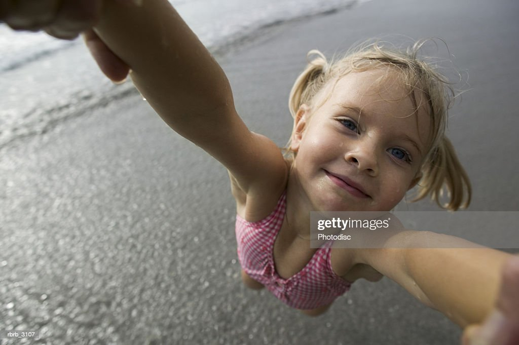 Close-up of a person spinning a girl at the beach : Foto de stock