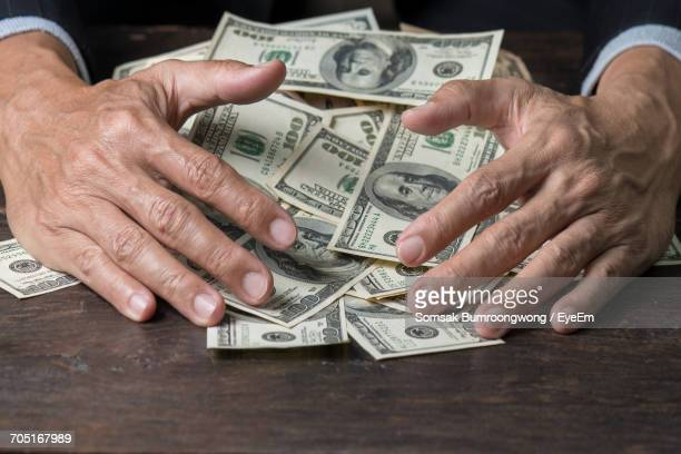 close-up of a person with a load of money - millionnaire stock photos and pictures