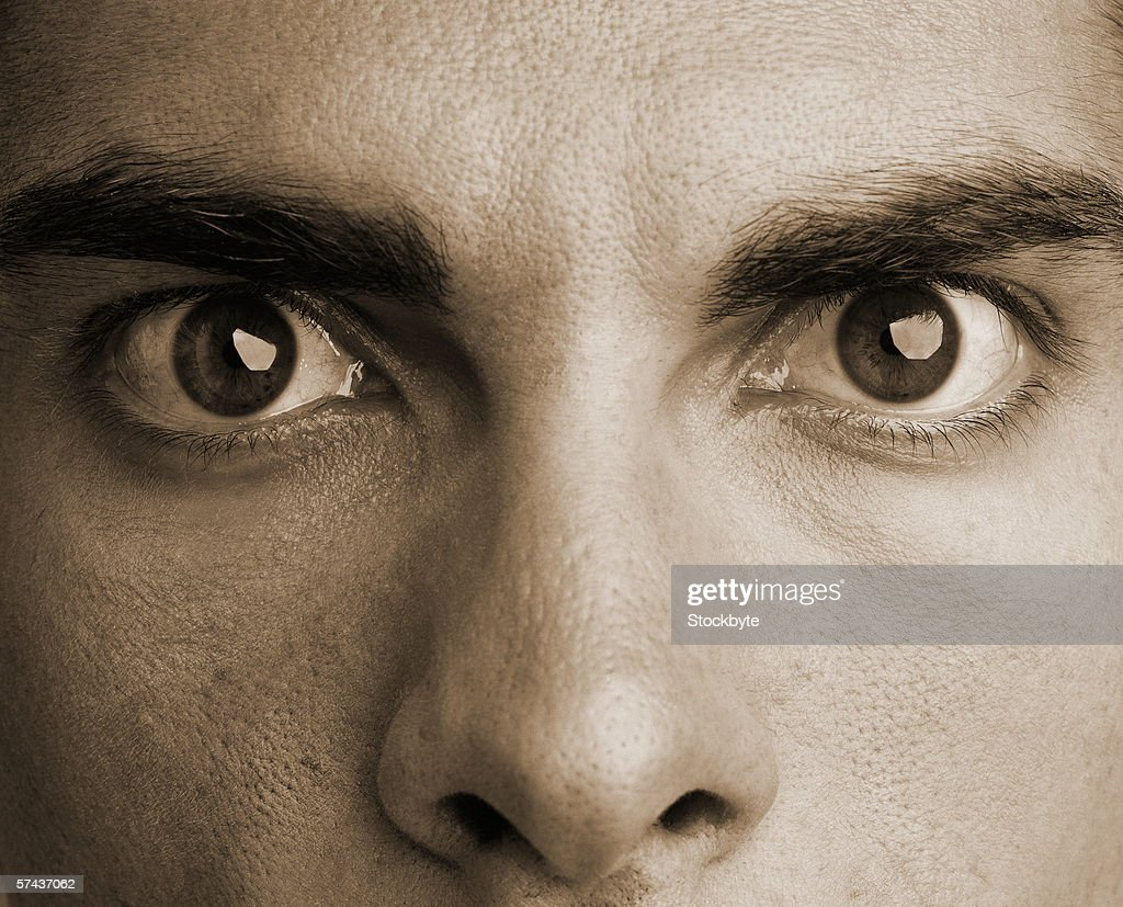 close-up of a person's eyes wide open (sepia) : Stock Photo