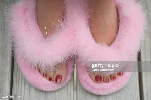 close-up of a person's feet wearing fur slippers - fluffy stock pictures, royalty-free photos & images