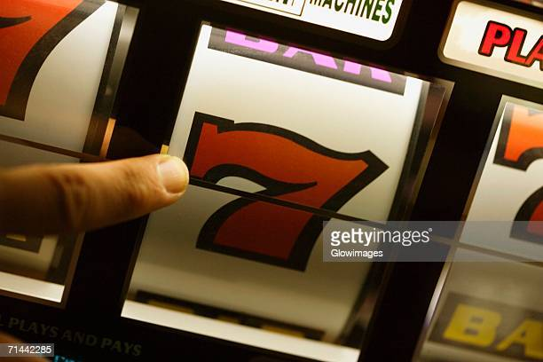Close-up of a person's finger operating a slot machine, Las Vegas, Nevada, USA
