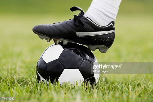 Close-up of a person's foot on a soccer ball
