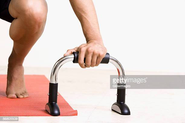 Close-up of a person's hand holding exercising equipment
