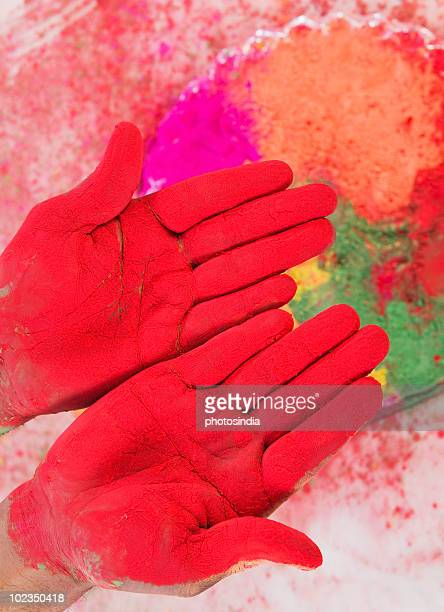 Close-up of a person's hands colored with Holi colors