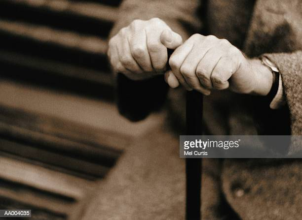 Close-up of a Person's Hands Holding Onto a Cane