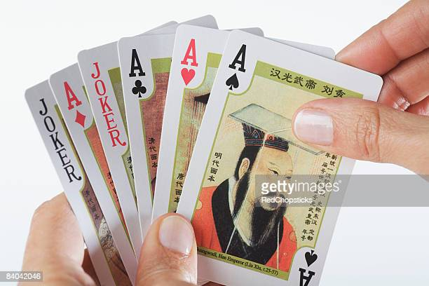 Close-up of a person's hands playing cards
