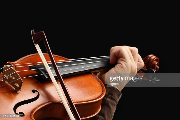 A close-up of a person's holding a violin