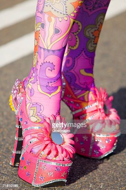 Close-up of a person's painted legs in high heels