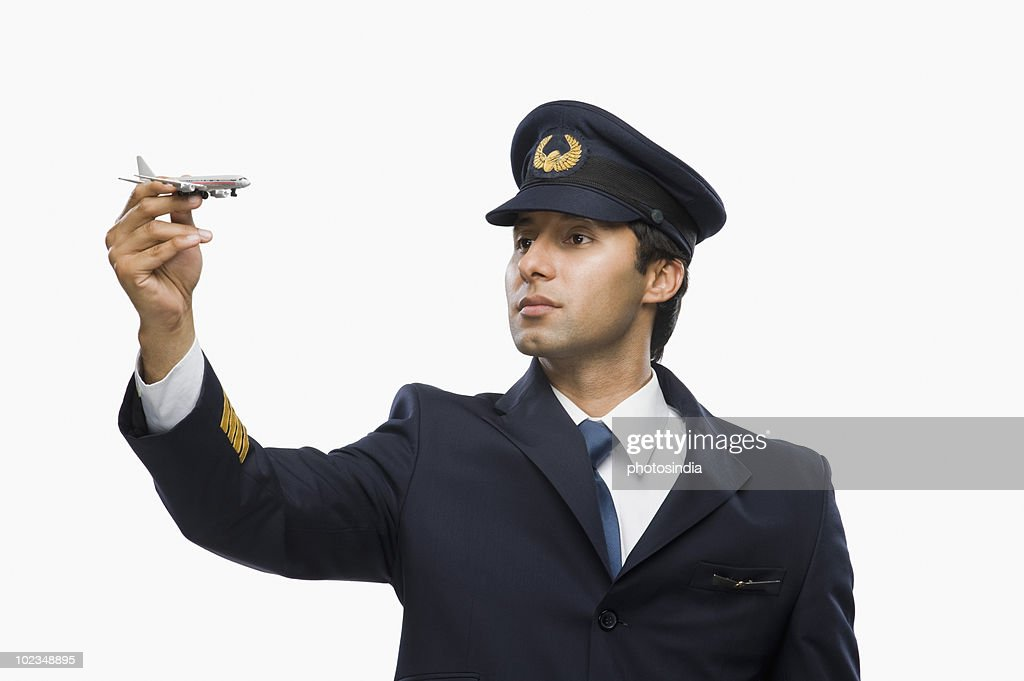 Close-up of a Pilot flying an aircraft toy : Stock Photo