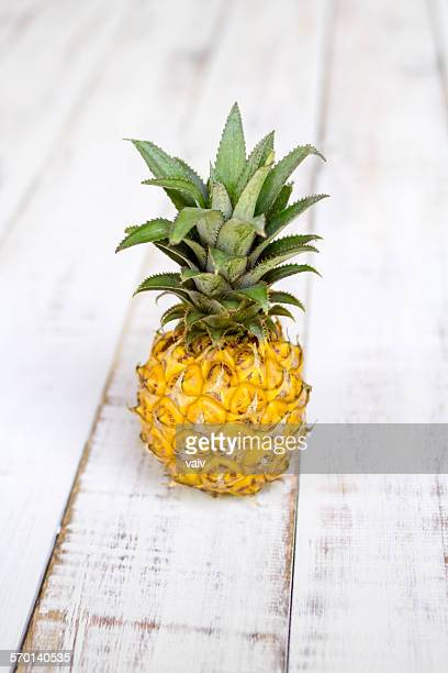 Close-up of a pineapple on a wooden table