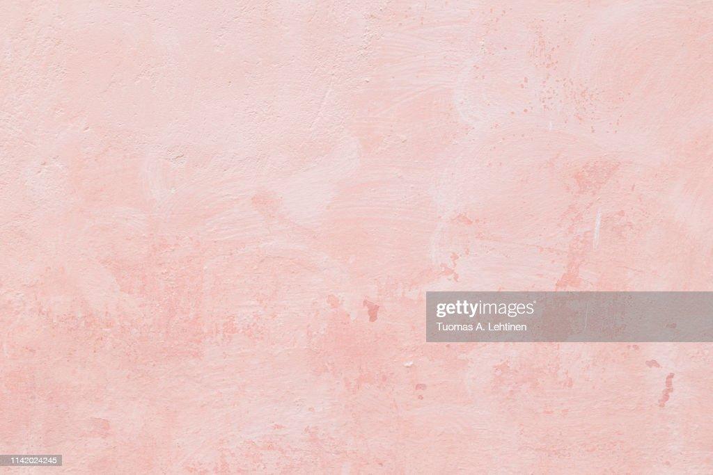 Closeup of a pink concrete wall : Stockfoto