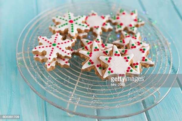 Close-up of a plate of snowflake and star shaped cookies