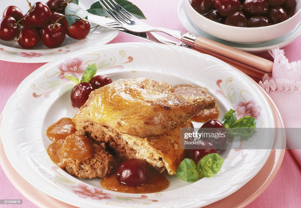 close-up of a portion of chicken served with condiments : Stock Photo