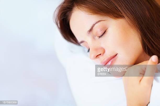 Closeup of a pretty female fast asleep in bed
