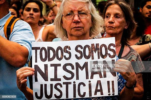 Closeup of a protester with a sign We are all Nisman Justice in the march for the death of the prosecutor Judge Alberto Nisman in the center of the...