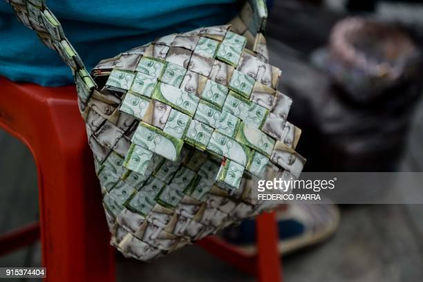 Closeup of a purse made by Venezuelan Wilmer Rojas out of Bolivar banknotes in Caracas on January 30 2018 A young Venezuelan tries to make a living...