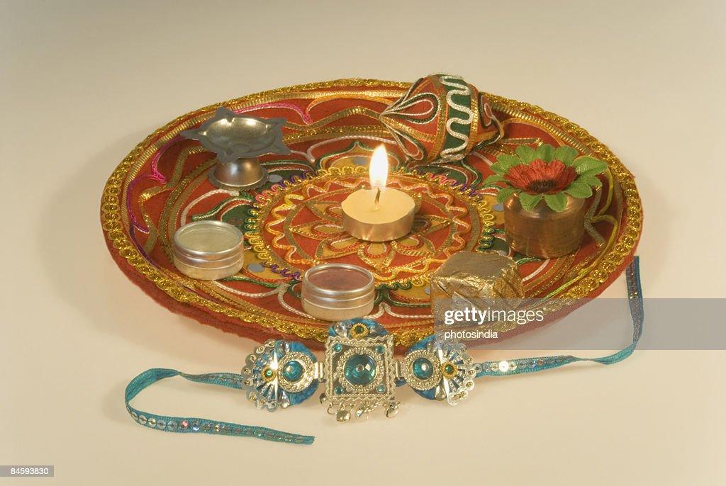 Close-up of a rakhi with a rakhi thali : Stock Photo
