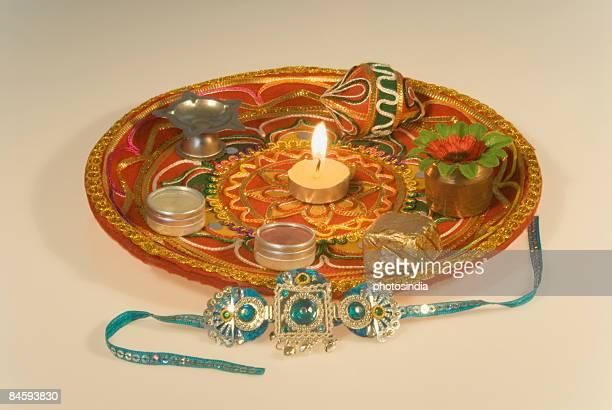 close-up of a rakhi with a rakhi thali - raksha bandhan stock photos and pictures