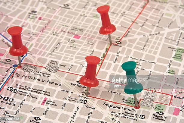 Close-up of a red and green pushpins on a travel map