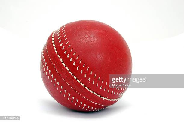 Close-up of a red cricket ball