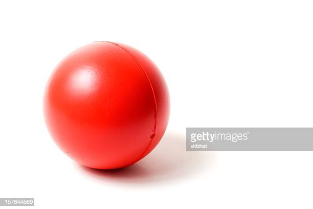 Close-up of a red rubber stress ball on white background