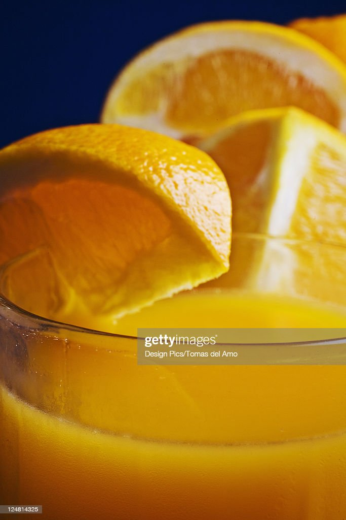Close-up of a refreshing glass of orange juice. : Stock Photo