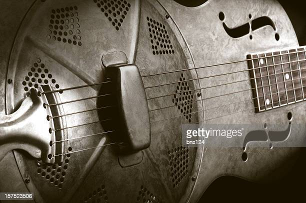 Close-up of a resonator guitar in sepia tones