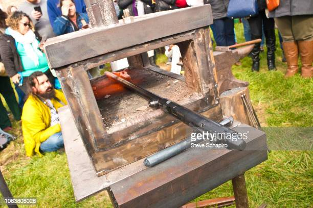 Closeup of a rifle barrel as it is heated in a portable forge during a demonstration at an antigun rally in the Englewood neighborhood Chicago...