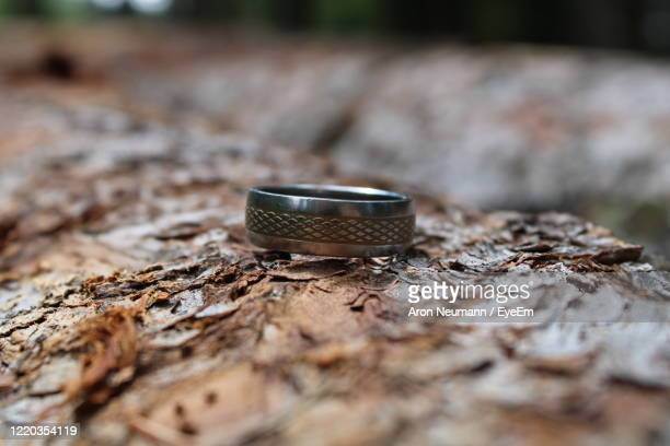 close-up of a ring on  wood - paris rocks stock pictures, royalty-free photos & images