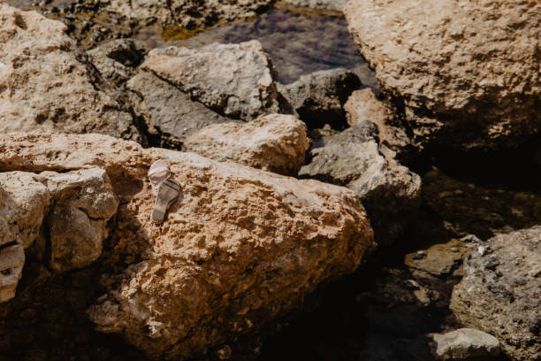 Close-Up Of A Rock Formation With Forgotten Sandals