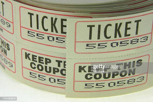 Closeup of a roll tickets with a coupon attached for proof of payment often used for a raffle or drawing