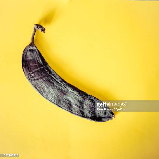 close-up of a rotten banana on yellow background - rot stock pictures, royalty-free photos & images