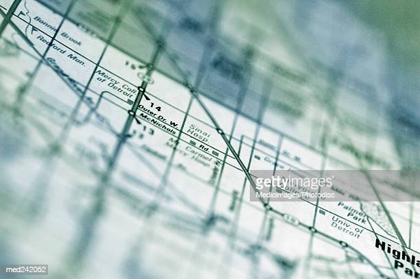 close-up of a route on a map - detroit michigan map stock pictures, royalty-free photos & images