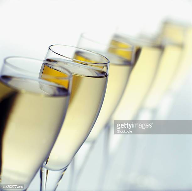 close-up of a row of champagne glasses
