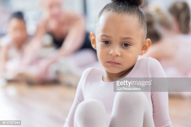 closeup of a sad young ballerina in time out - little girls dressed up wearing pantyhose stock photos and pictures
