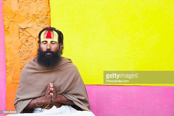 close-up of a sadhu praying - shawl stock photos and pictures