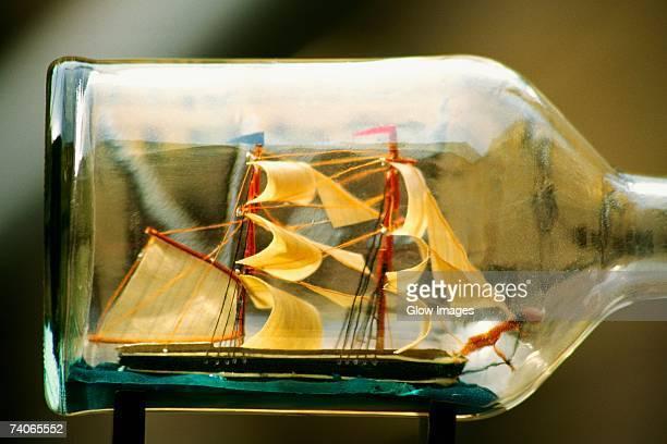 Close-up of a sailing ship inside a bottle, Nieuwe Spiegelstraat, Amsterdam, Netherlands