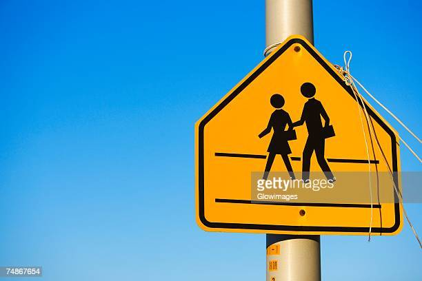 Close-up of a school crossing sign