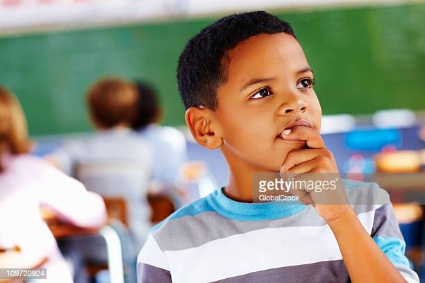 Close-up of a schoolboy thinking