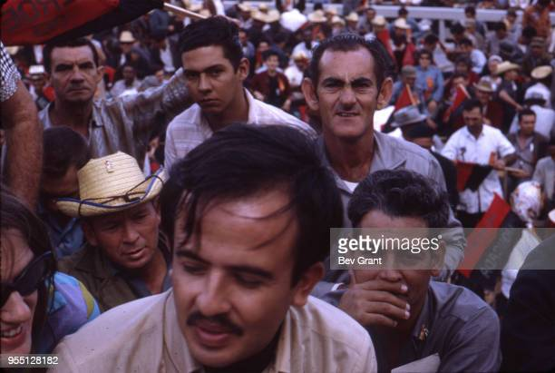 Closeup of a section of people in the audience in la Plaza de la Revolucion during the 10th anniversary celebration of the Cuban Revolution Havana...