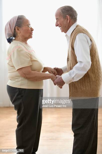 close-up of a senior couple talking - sweater vest stock photos and pictures
