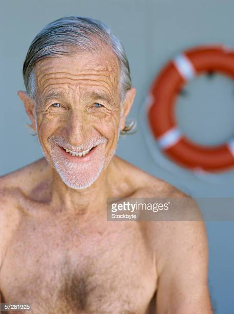 close-up of a senior man bare-chested and smiling - barechested bare chested ストックフォトと画像