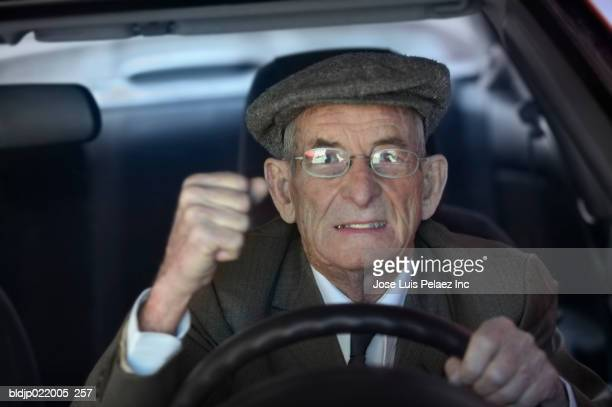 Close-up of a senior man driving a car