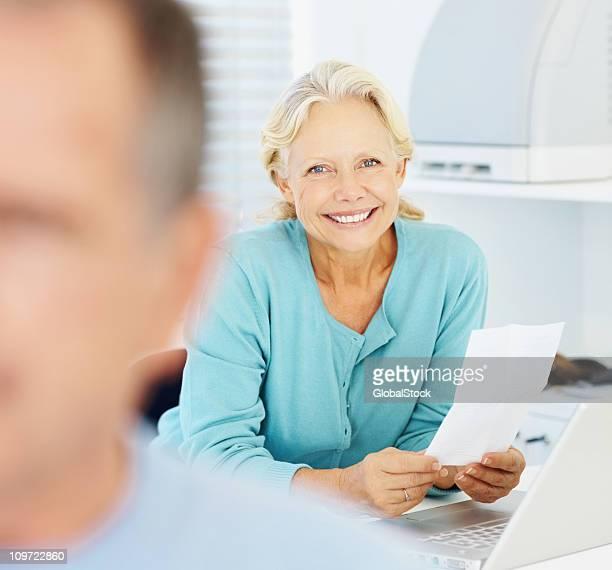 Closeup of a senior woman doing the bills