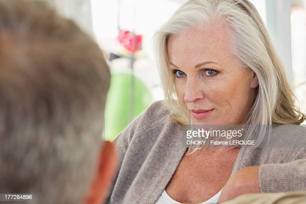 Close-up of a senior woman looking at her husband