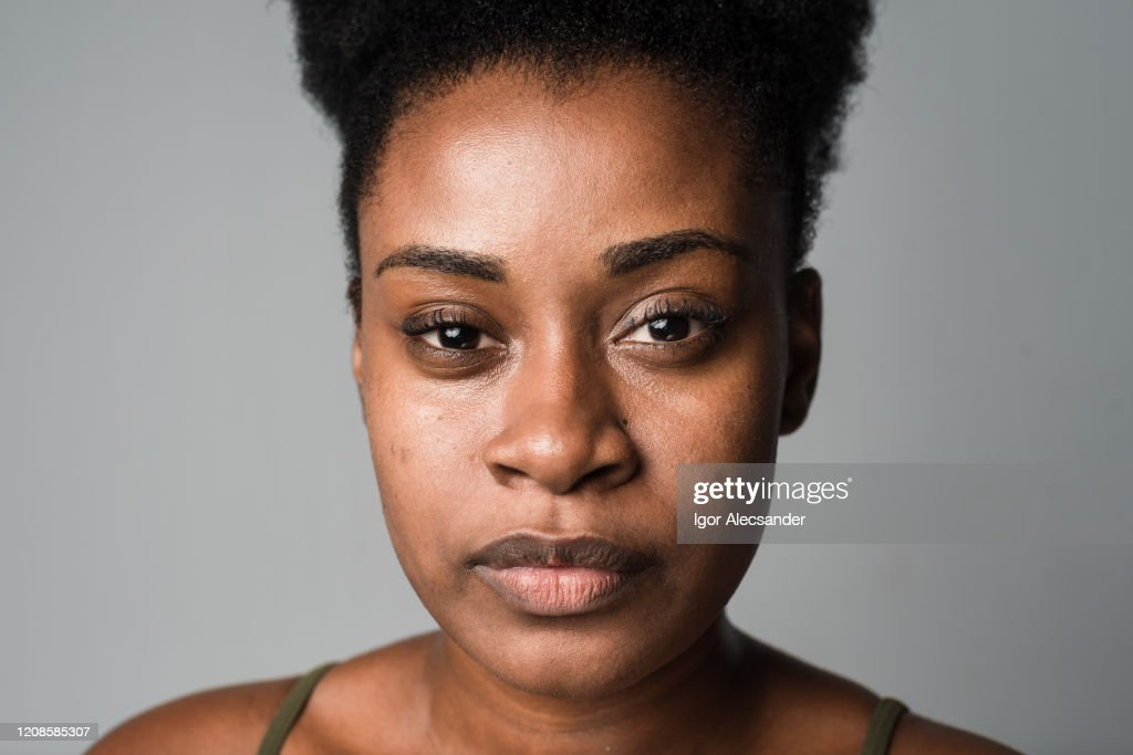 Close-up of a serious woman : Stock Photo