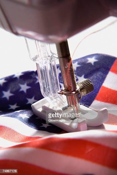 Close-up of a sewing machine stitching an American flag