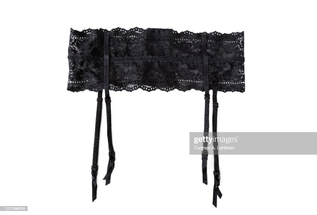 Close-up of a sexy black lacy garter or suspender belt, isolated on white background. : Stock Photo