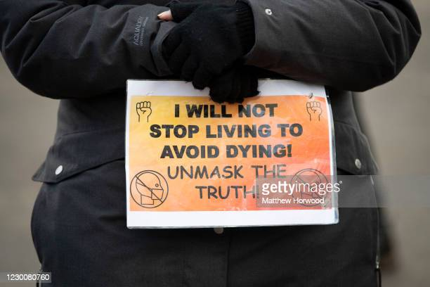 Close-up of a sign during an anti-vaccine protest which started at College Green on December 12, 2020 in Bristol, England. NHS staff, over-80s, and...